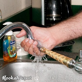 Cleaning Hookah in Kitchen Sink filling stem with water