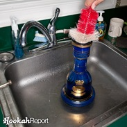 Cleaning hookah base with brush